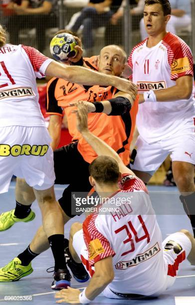 Luc Steins of The Netherlands holds the ball during the EC qualification handball match Denmark vs Netherlands in Almere on June 14 2017 / AFP PHOTO...