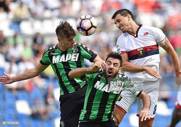 Luca Antei and Francesco Magnanelli of US Sassuolo and Nicolas Burdisso of Genoa CFC in action during the Serie A match between US Sassuolo and Genoa...