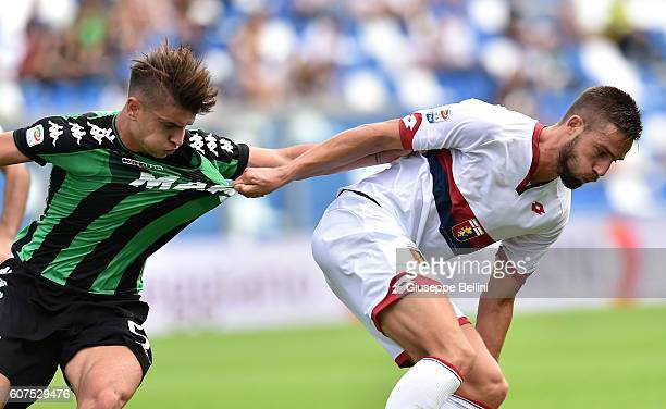 Luca Antei of US Sassuolo and Leonardo Pavoletti of Genoa CFC in action during the Serie A match between US Sassuolo and Genoa CFC at Mapei Stadium...
