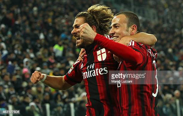 Luca Antonelli of AC Milan celebrates his goal with his teammate Alessio Cerci during the Serie A match between Juventus FC and AC Milan at Juventus...