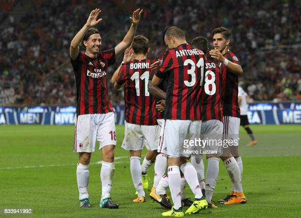 Luca Antonelli of AC Milan celebrates his goal with his teammate Riccardo Montolivo during the UEFA Europa League Qualifying PlayOffs round first leg...