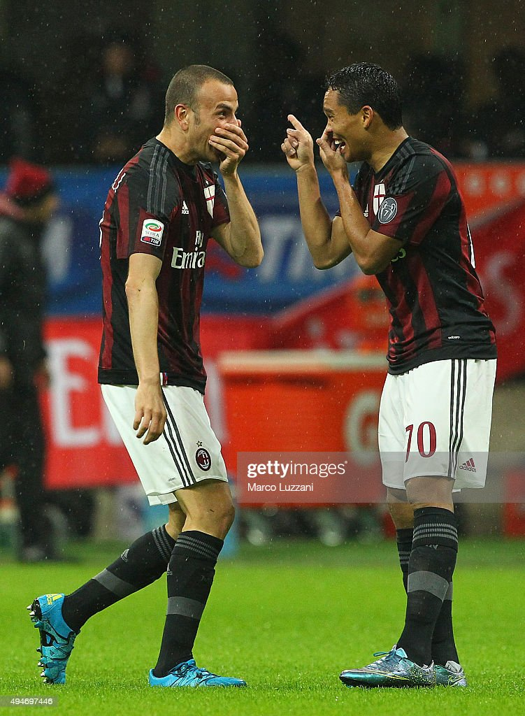 <a gi-track='captionPersonalityLinkClicked' href=/galleries/search?phrase=Luca+Antonelli&family=editorial&specificpeople=5358809 ng-click='$event.stopPropagation()'>Luca Antonelli</a> (L) of AC Milan celebrates with his team-mate <a gi-track='captionPersonalityLinkClicked' href=/galleries/search?phrase=Carlos+Bacca&family=editorial&specificpeople=6724246 ng-click='$event.stopPropagation()'>Carlos Bacca</a> (R) after scoring the opening goal during the Serie A match between AC Milan and AC Chievo Verona at Stadio Giuseppe Meazza on October 28, 2015 in Milan, Italy.