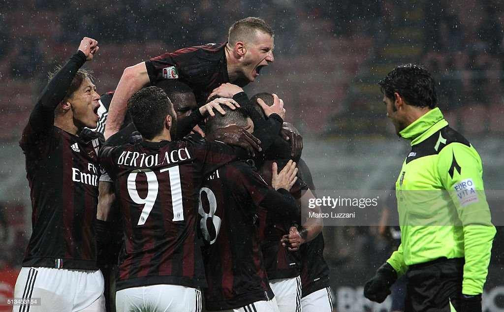 <a gi-track='captionPersonalityLinkClicked' href=/galleries/search?phrase=Luca+Antonelli&family=editorial&specificpeople=5358809 ng-click='$event.stopPropagation()'>Luca Antonelli</a> of AC Milan celebrates with his team-mates after scoring the opening goal during the Serie A match between AC Milan and Torino FC at Stadio Giuseppe Meazza on February 27, 2016 in Milan, Italy.