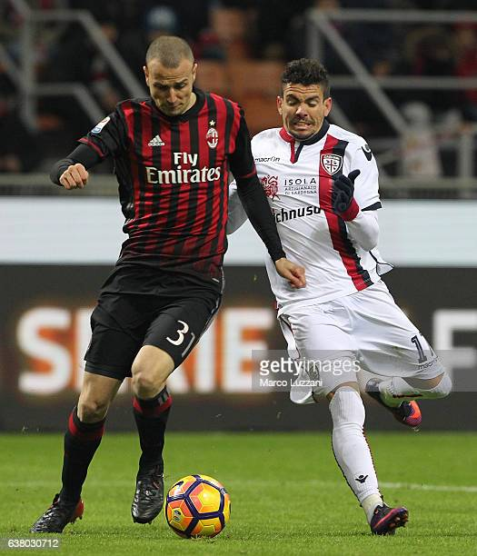 Luca Antonelli of AC Milan competes for the ball with Diego Farias Da Silva of Cagliari Calcio during the Serie A match between AC Milan and Cagliari...
