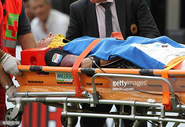 Luca Antonelli of AC Milan is helped from the pitch after sustaining an injury during the Serie A match between AC Milan and Udinese Calcio at Stadio...