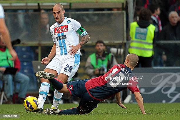 Luca Antonelli of Genoa CFC fights for the ball with Paolo Cannavaro of SSC Napoli during the Serie A match between Genoa CFC and SSC Napoli at...