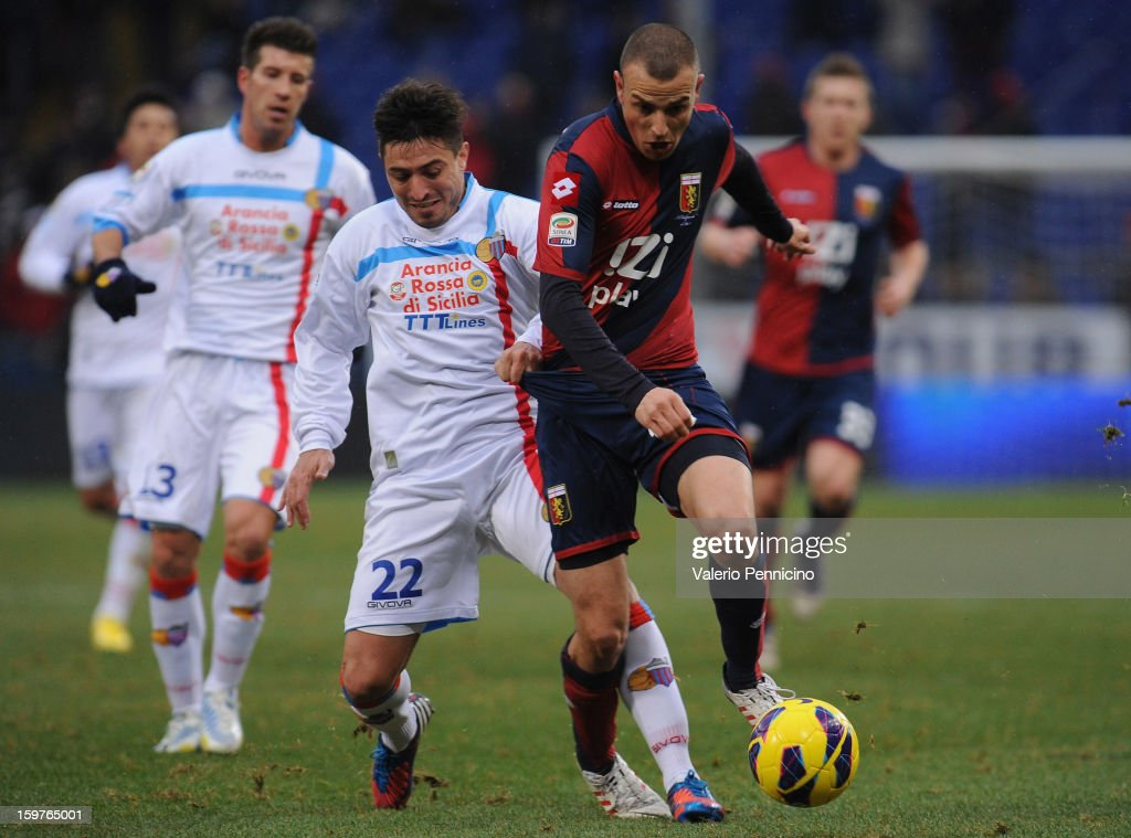Luca Antonelli (R) of Genoa CFC is challenged by Pablo Sebastian Alvarez of Calcio Catania during the Serie A match between Genoa CFC and Calcio Catania at Stadio Luigi Ferraris on January 20, 2013 in Genoa, Italy.