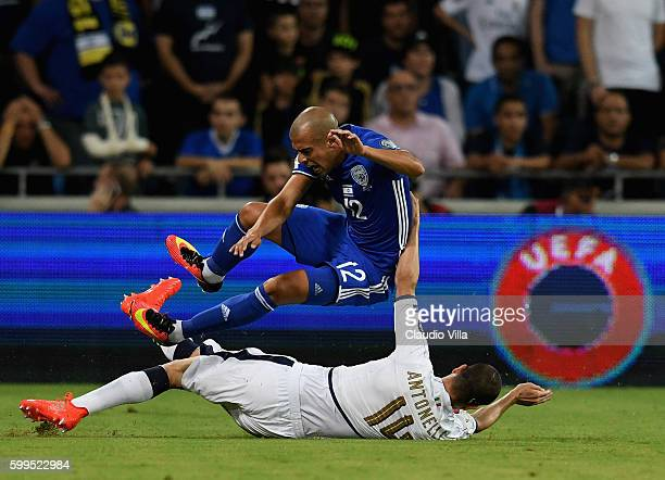 Luca Antonelli of Italy and Ben Chaim of Israel compete for the ball during the FIFA 2018 World Cup Qualifier between Israel and Italy at Itztadion...