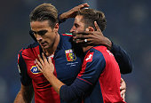 Luca Antonini of Genoa CFC celebrates a victory with his teammate Alessandro Matri at the end of the Serie A match between Genoa CFC and Juventus FC...