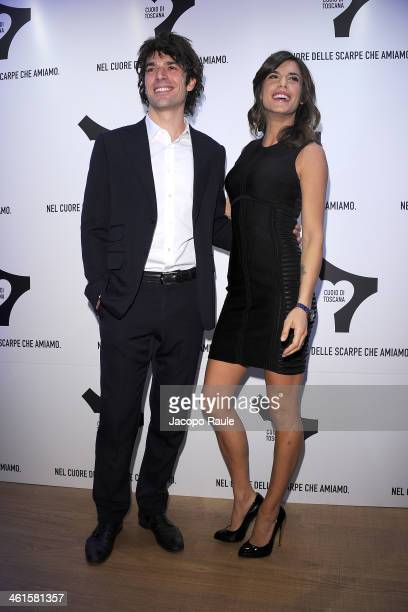 Luca Argentero and Elisabetta Canalis attend La Qualita Si Fa Arte By Cuoio Di Toscana Pitti Immagine Uomo 85 on January 9 2014 in Florence Italy