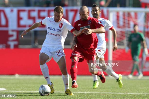 Luca Belingheri of Padova Calcio compete for the ball with Stefano Amadio of Teramo Calcio 1913 during the Lega Pro 17/18 group B match between...