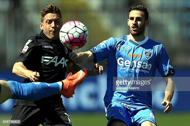 Luca Bittante of Empoli FC battles for the ball with Emanuele Giaccherini of Bologna Fc during the Serie A match between Empoli FC and Bologna FC at...