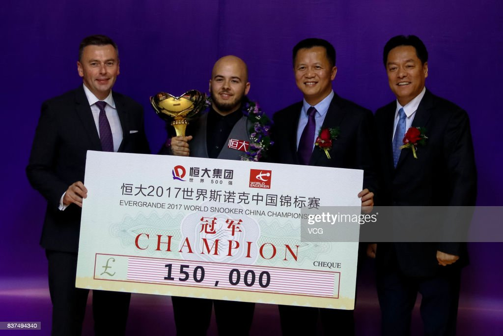 Luca Brecel (L2) of Belgium celebrates with his trophy after the final match against Shaun Murphy of England on day seven of Evergrande 2017 World Snooker China Champion at Guangzhou Sport University on August 22, 2017 in Guangzhou, Guangdong Province of China.
