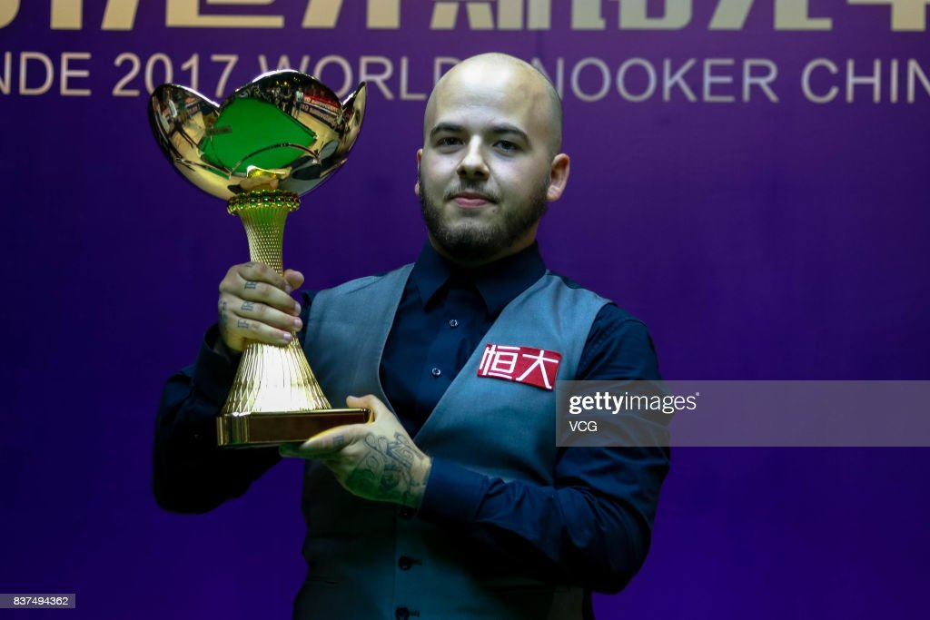 Luca Brecel of Belgium celebrates with his trophy after the final match against Shaun Murphy of England on day seven of Evergrande 2017 World Snooker China Champion at Guangzhou Sport University on August 22, 2017 in Guangzhou, Guangdong Province of China.