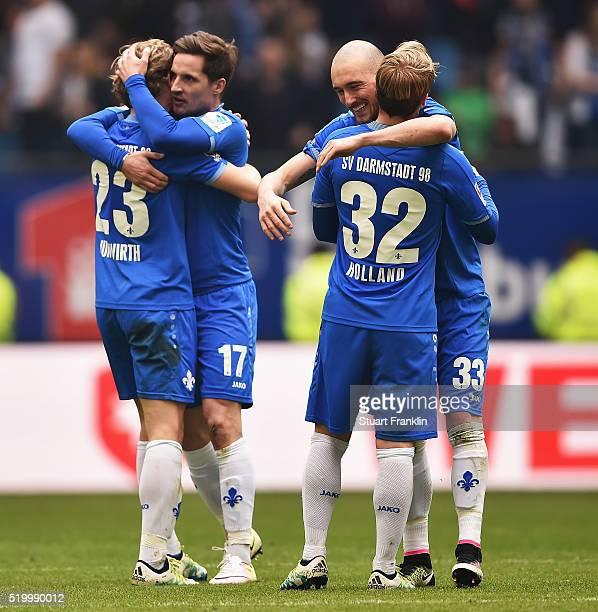 Luca Caldirola and Florian Jungwirth of Darmstadt celebrate during the Bundesliga match between Hamburger SV and SV Darmstadt 98 at Volksparkstadion...