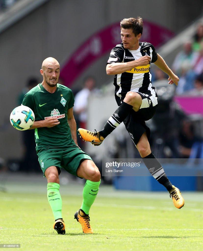 Luca Caldirola of Bremen challenges Jonas Hofmann of Moenchengladbach during the Telekom Cup 2017 match between Borussia Moenchengladbach and Werder Bremen at on July 15, 2017 in Moenchengladbach, Germany.