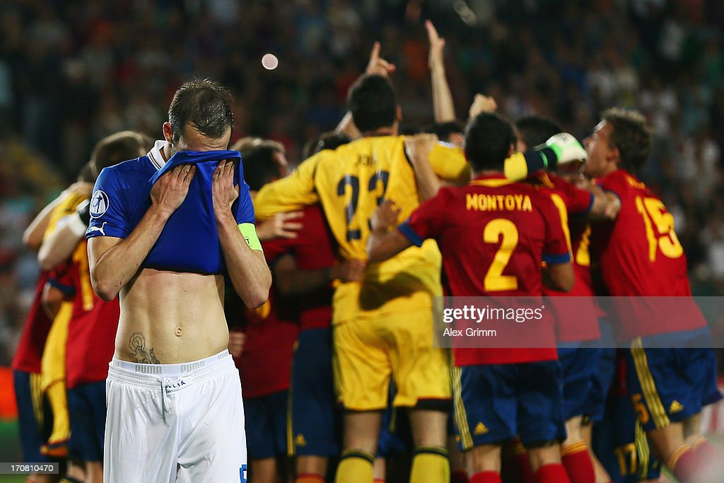 Luca Caldirola of Italy reacts as players of Spain celebrate winning the UEFA European U21 Championship final match at Teddy Stadium on June 18, 2013 in Jerusalem, Israel.