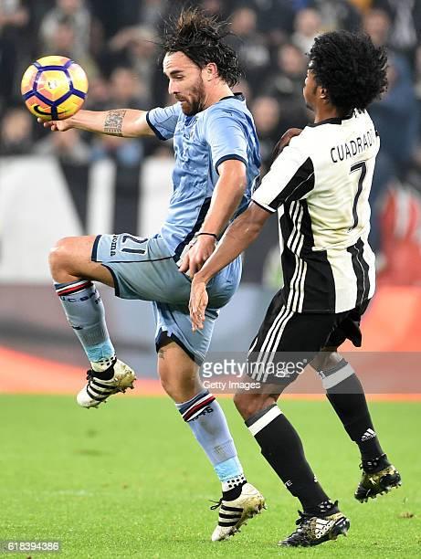 Luca Cigarini and Juan Cuadrado during the Serie A match between Juventus FC and UC Sampdoria at Juventus Stadium on October 26 2016 in Turin Italy
