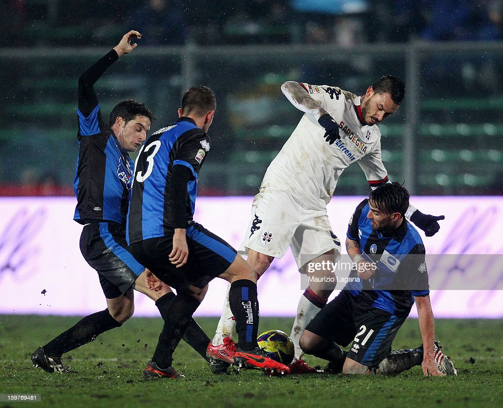 Luca Cigarini (R) and Michele Canin (C) of Atalanta compete for ball with Mauricio Pinilla of Cagliari during the Serie A match between Atalanta BC and Cagliari Calcio at Stadio Atleti Azzurri d'Italia on January 20, 2013 in Bergamo, Italy.