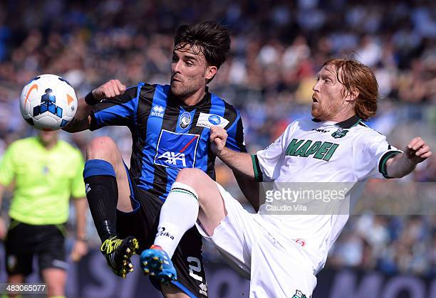 Luca Cigarini of Atalanta BC and Davide Biondini of US Sassuolo Calcio compete for the ball during the Serie A match between Atalanta BC and US...