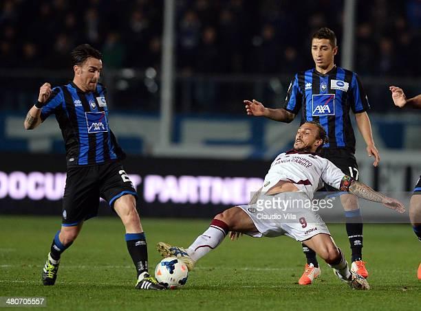 Luca Cigarini of Atalanta BC and Paulinho of AS Livorno Calcio compete for the ball during the Serie A match between Atalanta BC and AS Livorno...
