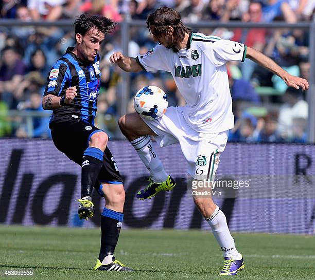 Luca Cigarini of Atalanta BC and Simone Missiroli of US Sassuolo Calcio compete for the ball during the Serie A match between Atalanta BC and US...