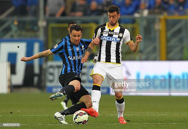 Luca Cigarini of Atalanta BC competes for the ball with Bruno Borges Fernandes of Udinese Calcio during the Serie A match between Atalanta BC and...