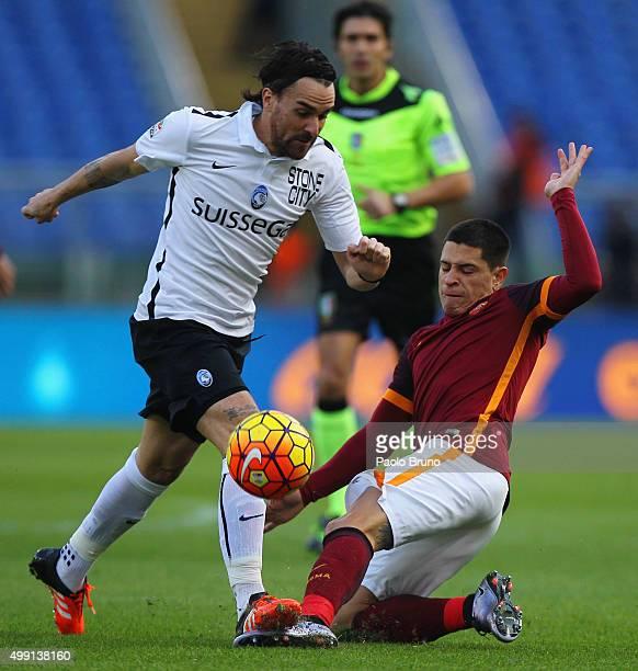 Luca Cigarini of Atalanta BC competes for the ball with Juan Manuel Iturbe of AS Roma during the Serie A match between AS Roma and Atalanta BC at...
