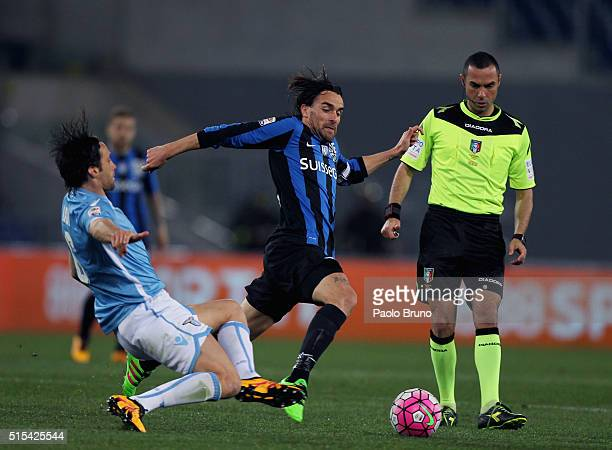 Luca Cigarini of Atalanta BC competes for the ball with Stefano Mauri of SS Lazio during the Serie A match between SS Lazio and Atalanta BC at Stadio...