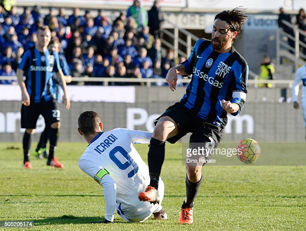 Luca Cigarini of Atalanta BC competes with Mauro Icardi of Internazionale Milano during the Serie A match between Atalanta BC and FC Internazionale...