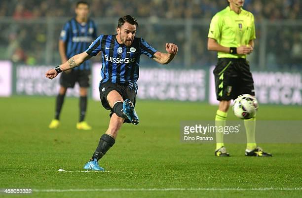 Luca Cigarini of Atalanta BC kicks the ball during the Serie A match between Atalanta BC and SSC Napoli at Stadio Atleti Azzurri d'Italia on October...