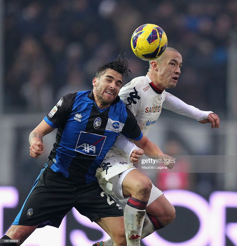 <a gi-track='captionPersonalityLinkClicked' href=/galleries/search?phrase=Luca+Cigarini&family=editorial&specificpeople=3933790 ng-click='$event.stopPropagation()'>Luca Cigarini</a> (L) of Atalanta competes for ball in air with Radja Nainggolan of Cagliari during the Serie A match between Atalanta BC and Cagliari Calcio at Stadio Atleti Azzurri d'Italia on January 20, 2013 in Bergamo, Italy.