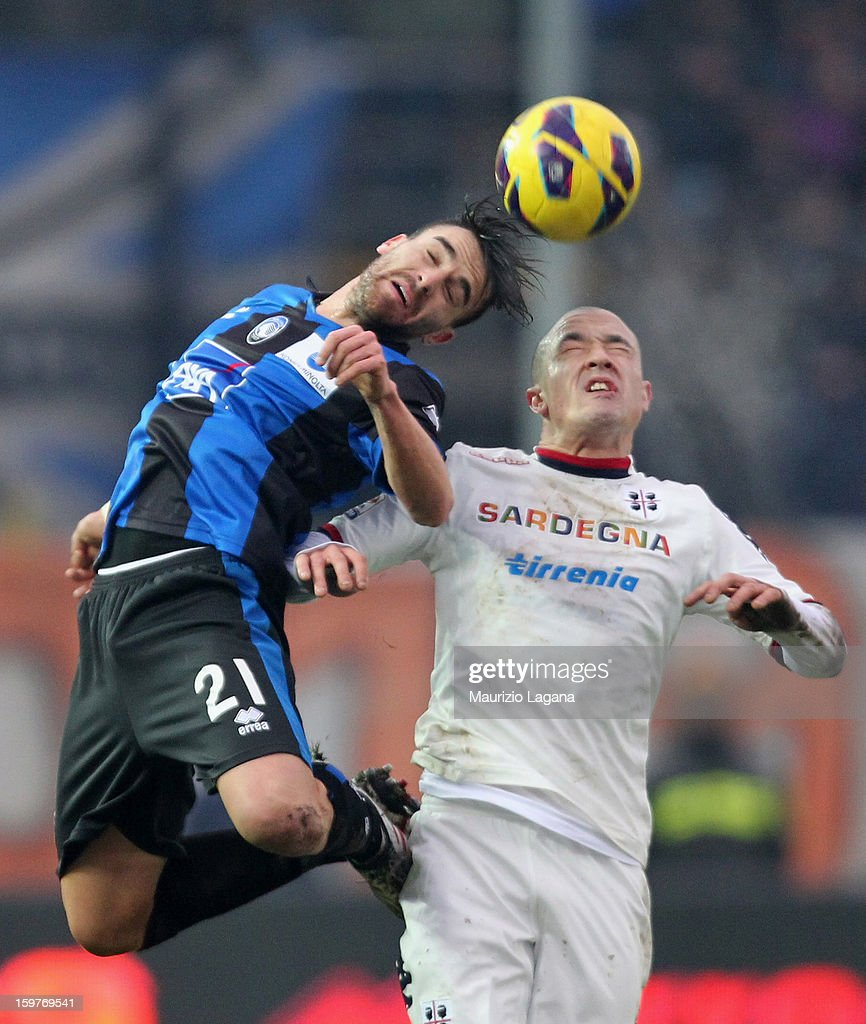 <a gi-track='captionPersonalityLinkClicked' href=/galleries/search?phrase=Luca+Cigarini&family=editorial&specificpeople=3933790 ng-click='$event.stopPropagation()'>Luca Cigarini</a> (L) of Atalanta competes for ball in the air with Radja Nainggolan of Cagliari during the Serie A match between Atalanta BC and Cagliari Calcio at Stadio Atleti Azzurri d'Italia on January 20, 2013 in Bergamo, Italy.