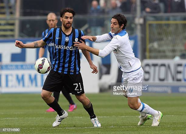 Luca Cigarini of Atalanta competes for the ball with Daniele Croce of Empoli during the Serie A match between Atalanta BC and Empoli FC at Stadio...