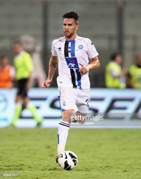 Luca Cigarini of Catania competes for the ball with German Denis of Atalanta during the Serie A match between Calcio Catania and Atalanta BC at...