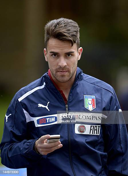 Luca Cigarini of Italy uses his mobile phone during a training session at Coverciano on May 21 2012 in Florence Italy