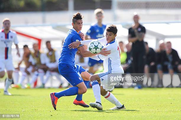Luca COCCOLO of Juventus and Houssem AOUAR of Lyon during the Youth League match between Lyon and Juventus at Plaine des Jeux de Gerland on October...
