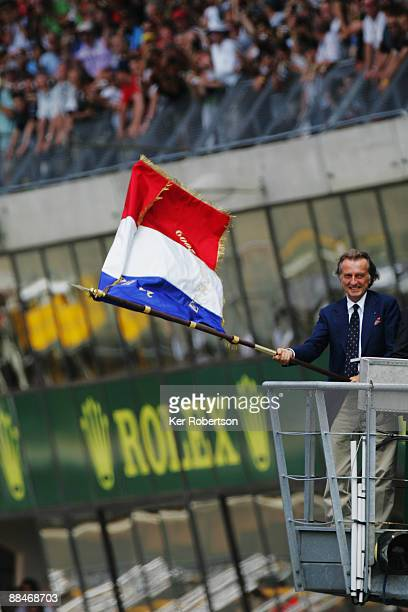 Luca Cordero di Montezemolo Chairman of Ferrari waves the French Tricolour to start the 77th running of the Le Mans 24 Hour race at the Circuit des...