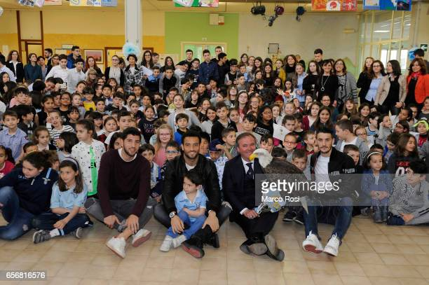 Luca Crecco Felipe Anderson the symbol of SS Lazio Olimpia and Luis Alberto of SS Lazio during the meets school students with his teammates at the...