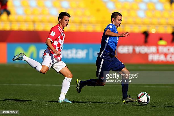 Luca de la Torre of USA and Josip Brekalo of Croatia battle for the ball during the FIFA U17 Men's World Cup 2015 group A match between USA and...