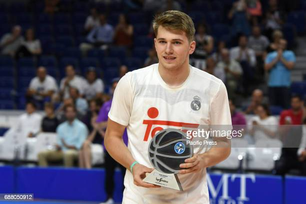 Luca Doncic of Real Madrid poses with his trophy of Best Young Player in Europe at WinZink center in Madrid Real Madrid beat Morabanc Andorra 10776...