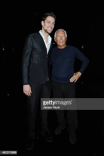 Luca Dotto and Giorgio Armani attend the Emporio Armani show as a part of Milan Fashion Week Menswear Autumn/Winter 2014 on January 13 2014 in Milan...