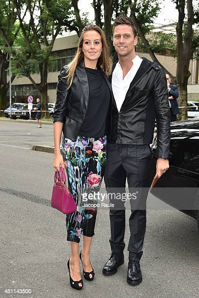 Luca Dotto and Rossella Fiamingo arrive at Giorgio Armani show during Milan Fashion Week Menswear Spring/Summer 2015 on June 24 2014 in Milan Italy