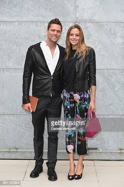 Luca Dotto and Rossella Fiamingo attend Giorgio Armani show during Milan Menswear Fashion Week Spring Summer 2015 on June 24 2014 in Milan Italy