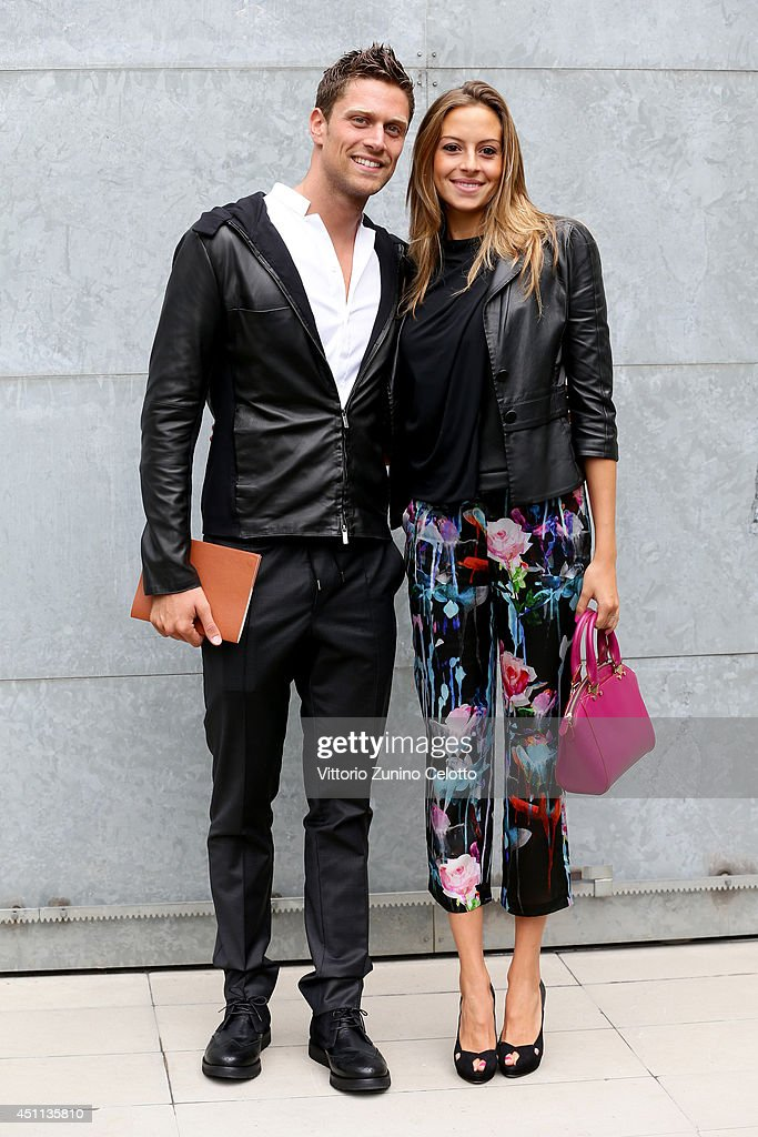 Luca Dotto and Rossella Fiamingo attend Giorgio Armani show during Milan Menswear Fashion Week Spring Summer 2015 on June 24, 2014 in Milan, Italy.