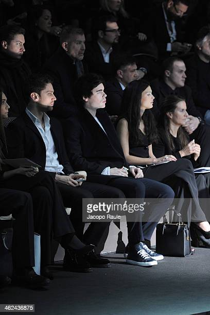 Luca Dotto Leon Else and Nathalie Dompe attend the Emporio Armani show as a part of Milan Fashion Week Menswear Autumn/Winter 2014 on January 13 2014...