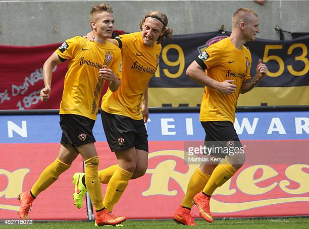 Luca Duerholtz of Dresden celebrates with team mates after scoring the second goal during the third league match between SG Dynamo Dresden and VFB...