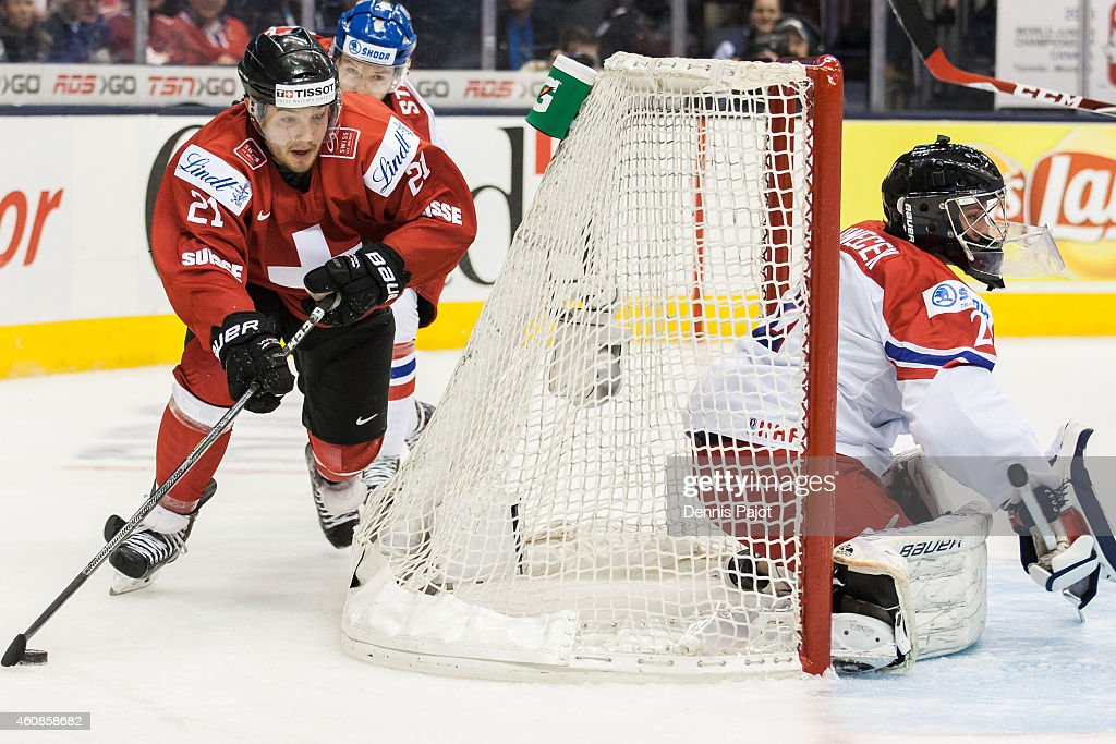Luca Fazzini #21 of Switzerland moves the puck against Vitek Vanecek #2 of Czech Republic during the 2015 IIHF World Junior Championship on December 27, 2014 at the Air Canada Centre in Toronto, Ontario, Canada.