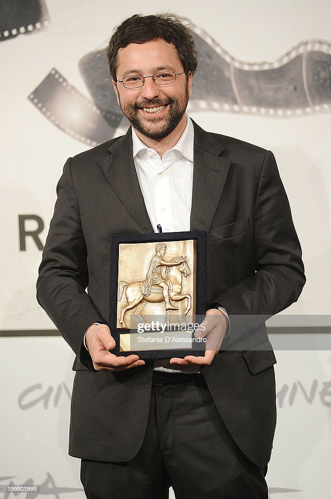 Luca Ferrari poses with his Prospettive Award for Best Documentary during the Award Winners Photocall on November 17, 2012 in Rome, Italy.