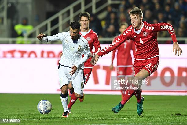 Luca Garritano of Italy is challenged by Patrick Banggaard of Denmark during the International Friendly match between Italy U21 and Denmark U21 at...